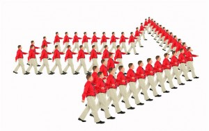 marching businessmen in red shirts arrow pointer collage